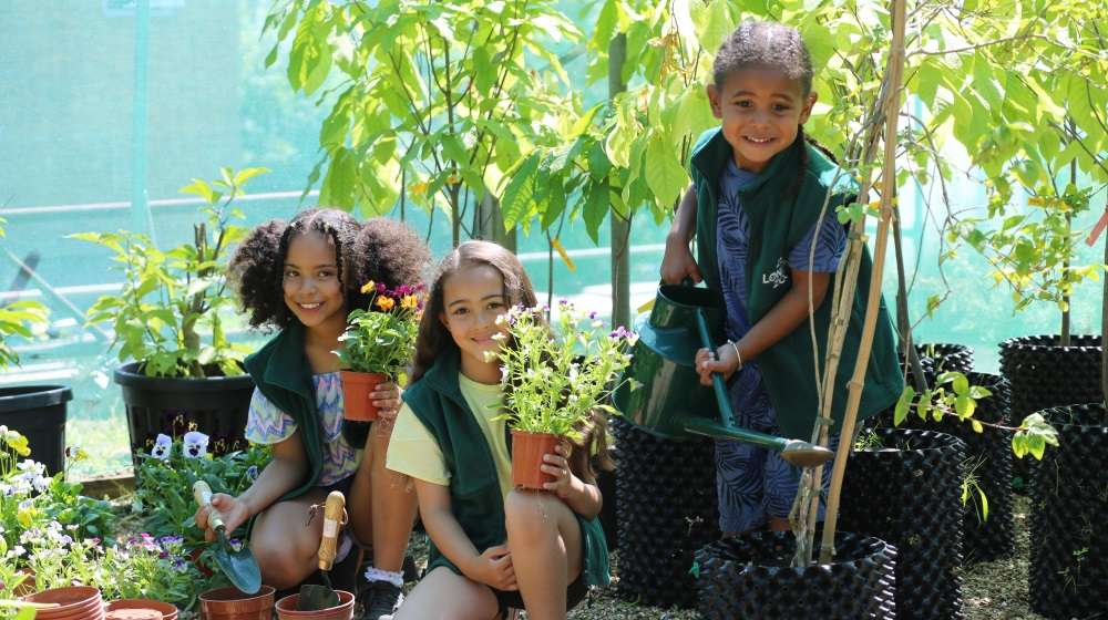 Children taking part in gardening activities as part of Zoo It Yourself at ZSL London Zoo