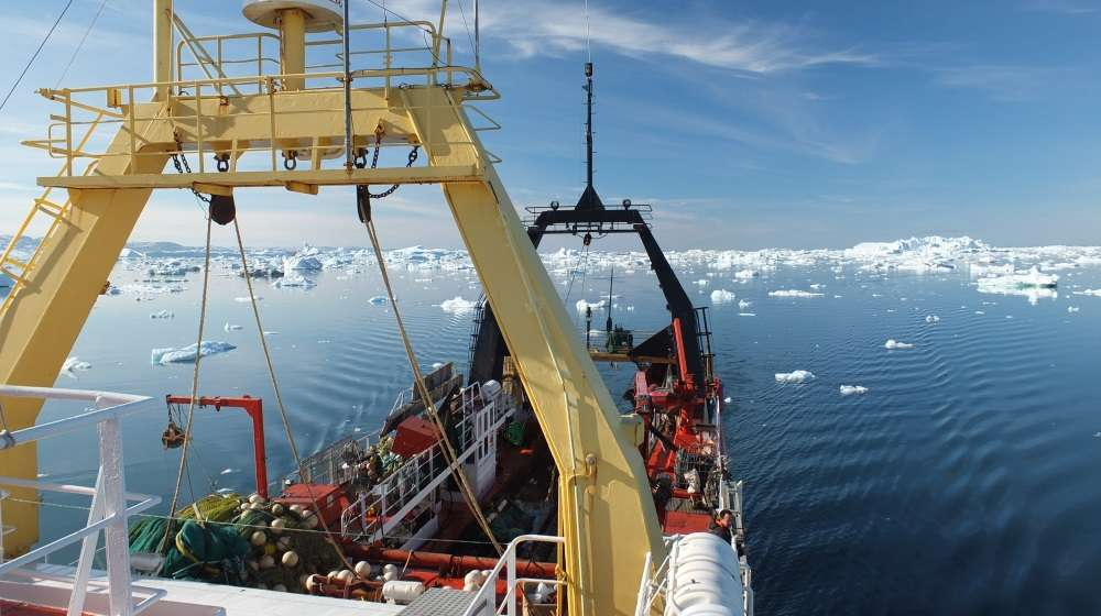 The research vessel Paamiut navigates through icebergs in Disko Bay, west Greenland