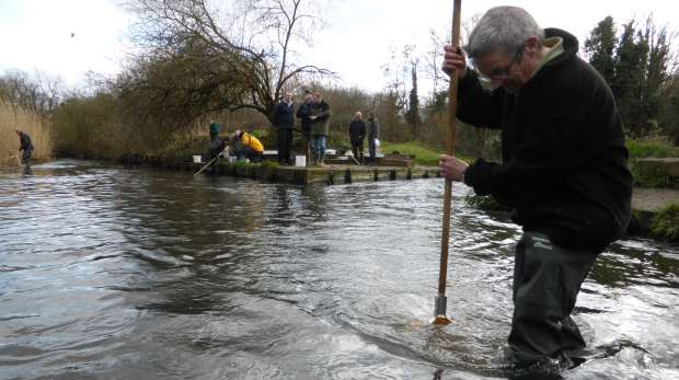 Citizen science volunteers being trained in the RMI sampling method on the River Crane