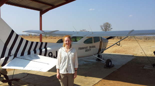 Ruth standing by the small four-seater plane she'd just been flying in
