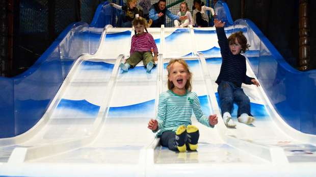 Children on a slide at Hullabazoo Indoor Play
