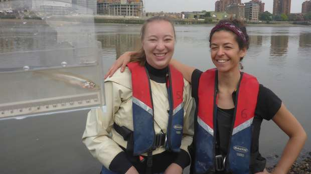 Jennifer McCard and Clara Obregon with juvenile European smelt