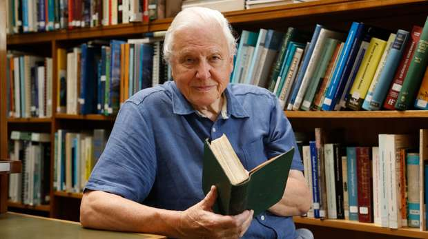 David Attenborough with the Origin of Species in the ZSL library