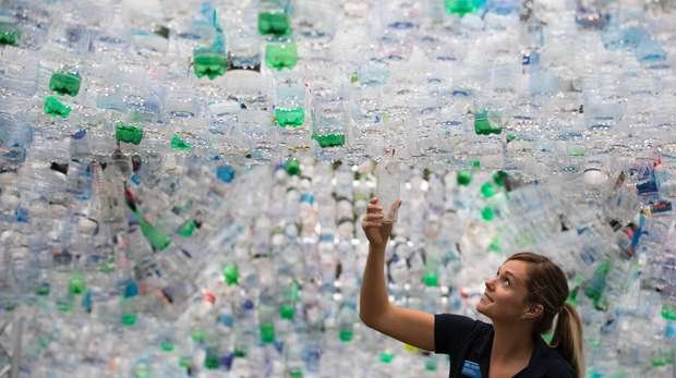 ZSL's Fiona Llewellyn places last bottle on Space of Waste at ZSL London Zoo (c)David Parry