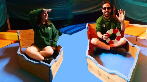 two zookeepers in boats