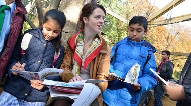 A teacher with students in the lemur exhibit at ZSL London Zoo