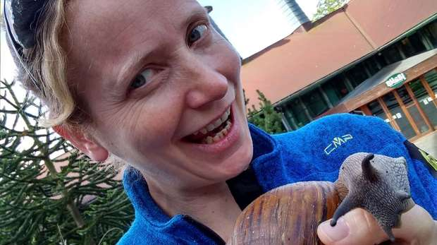 Photo - Selfie of Dr. Monika Bohm holding a giant African snail
