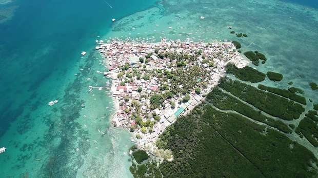 Photo - Aerial photo of a tropical coastline, taken from a drone