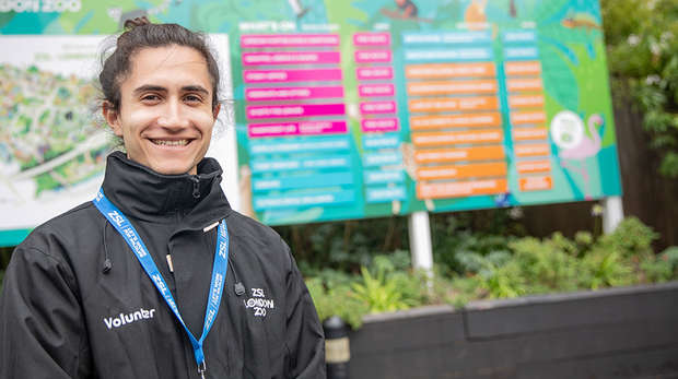 staff member at London zoo wearing uniform and smiling