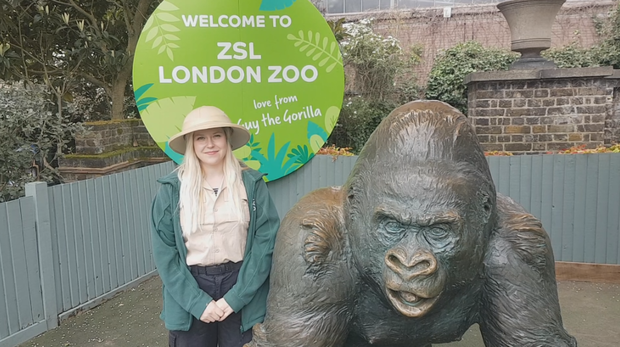 Jodie with Guy the gorilla statue at ZSL London Zoo