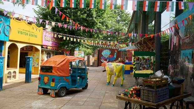 Brightly coloured stalls and shop fronts surrounding the Land of the Lions courtyard