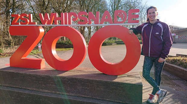 lady standing in front of Whipsnade Zoo sign