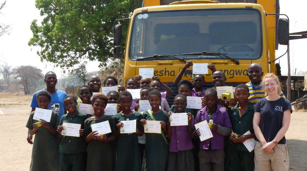 The students and Ruth with their certificates