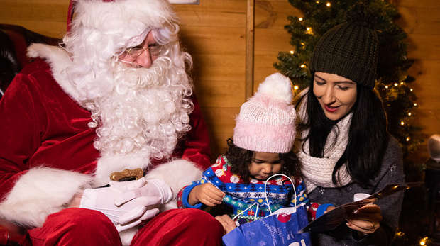 A child meeting Santa at the Zoo