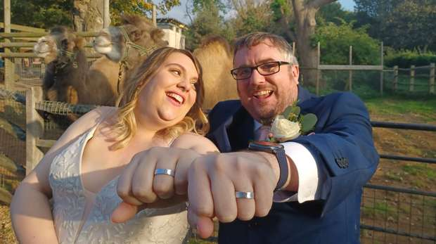 Matt Robbins and Alison Russell show off their wedding rings at ZSL London Zoo