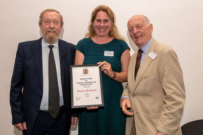 Photo of Sir John Beddington and Peter Titley with Annette Broderick holding her award.