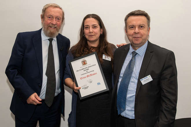 Photo of Sir John Beddington and Nigel Robinson with Erica McAlister holding her award.