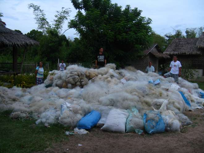 Abandoned nets collected by locals to turn in to carpet tiles