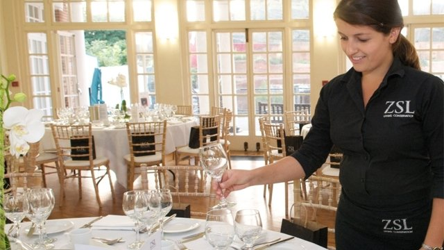 Waitress serving at event in Mappin Pavilion