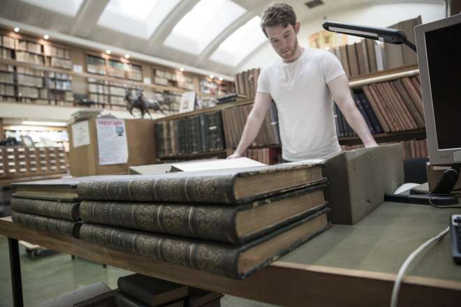 David Lowther ZSL Library's 2014 Visiting Scholar looking through works of John Gould