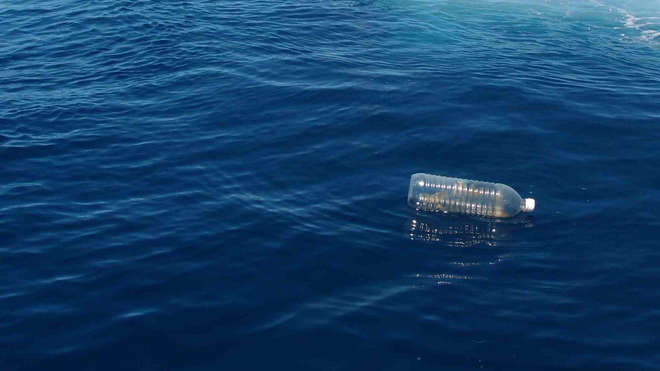 Plastic water bottle in the ocean