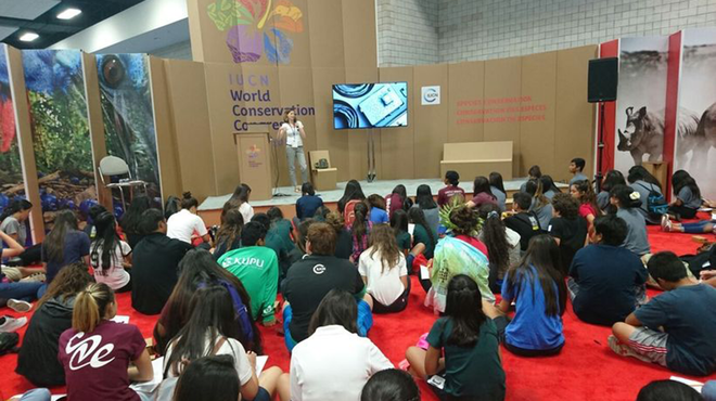 ZSL's Louise Hartley presenting Instant Wild to some of the 900 local Hawaiian students visiting the IUCN World Conservation Congress on Students Day