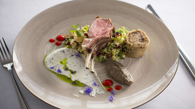 Roast rack of lamb and Morrocan spiced shoulder in Brik pastry, cauliflower and pistachio cous cous, Baba ganoush and a garlic buttermilk dressing