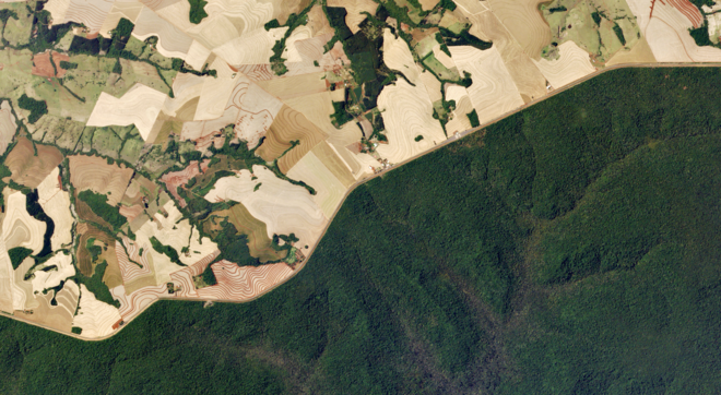 Satellite image of protected forest in the Amazon adjacent to converted agricultural land © Planet Labs