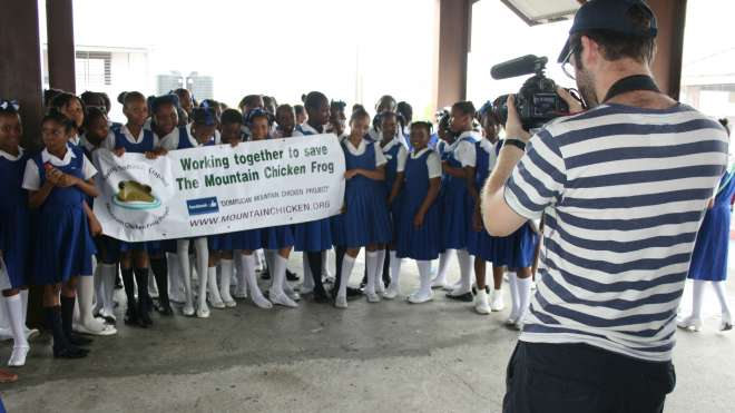 Dan John filming school children in Dominica as part of the Mountain Chicken Frog Project outreach programme.
