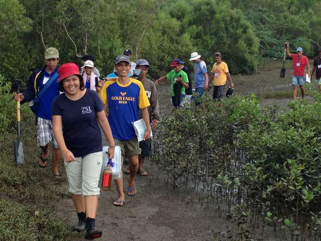 Rona Joy Loma with mangrove community members