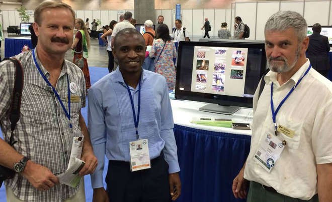 Jonas gives a presentation about bushmeat in the Democratic Republic of Congo at the IUCN WCC