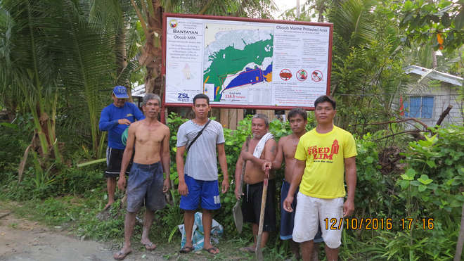 Francis Mari Remulta (in grey) with the marine protection area team in Oboob, Bantayan