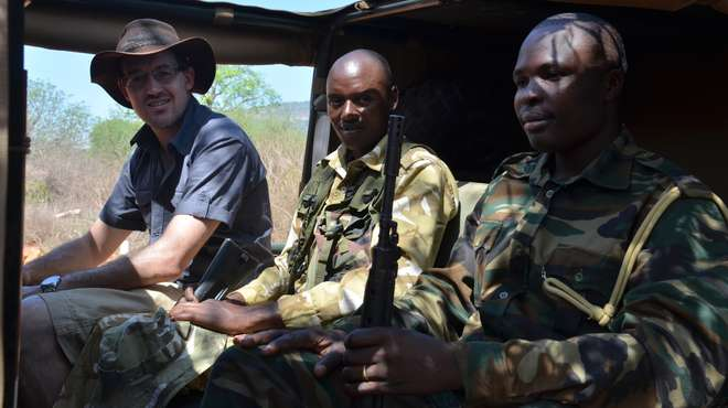 Chris Gordon in patrol vehicle with security rangers