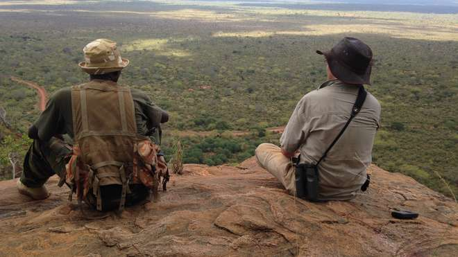 Chris and security ranger looking out over Tsavo