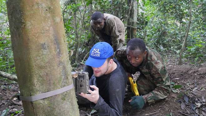 ZSL team setting up camera-trap near potential pangolin site