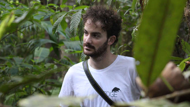 Photograph of EDGE Fellow Tomas Aguirre in the jungle