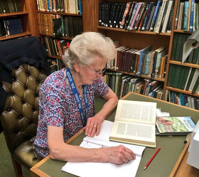 Beryl in ZSL Library & Archives carrying out desk research for her blog