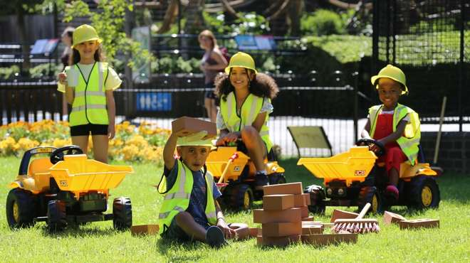 Children playing with diggers as part of Zoo It Yourself at ZSL London Zoo