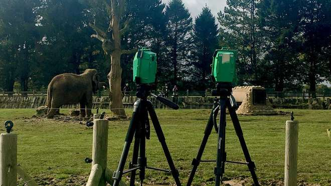 Photo - 2 thermal imaging cameras pointed towards the open-air elephant enclosure while an elephant is feeding.