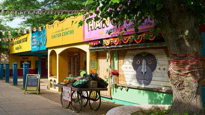 Photo - A colourful Indian themed marketplace replica with brightly painted shops and stalls
