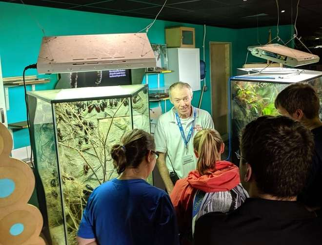 Volunteer Rob talking to visitors in the Butterfly House at Whipsnade Zoo